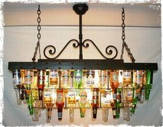make a beer bottle chandelier - very crafty . mmmm, I dunno - I kind of like this idea for over my pool table. and maybe make another one out of champagne/wine bottles for the dining room. I (Champagne Bottle Chandelier) Beer Bottle Chandelier, Bottle Lamps, Bottle Candles, Bottle Lights, Pool Table, Pool Bar, Game Room, Home Projects, Mosaic Projects