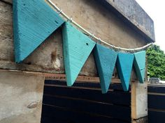 Heres a really simple garden project DIY wooden bunting. Were building a treeho… Heres a really simple garden project DIY wooden bunting. Were building a treehouse for the kids in our garden. I say treehouse b Diy Wooden Bunting, Wooden Flag, Fabric Bunting, Wooden Diy, Diy Outdoor Bunting, Garden Bunting, Bunting Ideas, Wooden Cake, Wooden Garden