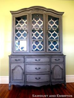 distressed paint on outside and wallpaper on inside of china cabinet