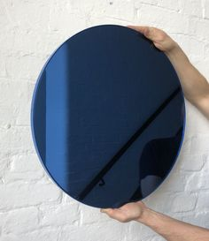 "Delightful blue tinted round mirror with a smart blue frame. Designed and hand-crafted in London, UK. The detailing and finish, including visible brass screws, emphasize the crafty and quality feel of the mirror, a true signature of our brand.  Supplied fully fitted with a specialist hanging system for an easy installation.  Also available in:   Small: 40cm/15.8""  Regular: 50cm/19.7""  Medium: 60cm/23.6""  Large: 79cm/31.1""  Extra Large: 100cm/39.4""  Depth 18mm"