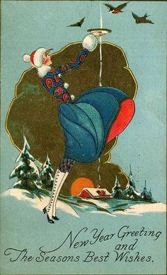 20's woman feeding birds in snow Happy New Year