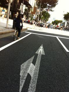 white arrows on dark gray road
