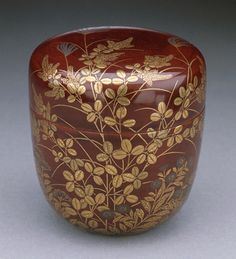 """virtual-artifacts: """"Covered Tea Carrier with Design of Autumn Grasses Alternate Title: Natsume Anonymous Japan, 19th century Furnishings; Accessories Red lacquer with gold leaves, grasses, and flowers 2 5/8 x 2 3/8 in. (6.7 x 6.0 cm) Gift of Miss..."""