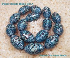 These beads are a new shape I call olives. They are a cross between a bi cone and a tube bead. They have the graduated ends like a bi cone a...