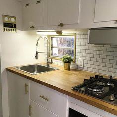 A little Tic Tac Tiles to dress up the vintage camper kitchen!