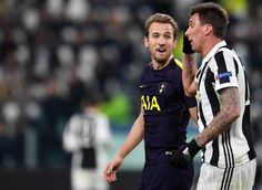 Mauricio Pochettino, Manager of Tottenham Hotspur argues with Mario Mandzukic of Juventus during the UEFA Champions League Round of 16 First Leg match between Juventus and Tottenham Hotspur at Allianz Stadium on February 13, 2018 in Turin, Italy.