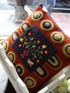 Lyn Hosford's Penny for Your Heart wool applique design for Need'l Love's Folk Heart Threads, created by another wool lover as a darling pillow.