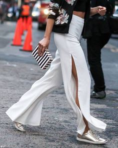 High slit flowing white trousers