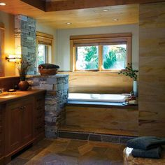 Stone and wood make for an earthy, relaxed vibe in this spa bath retreat.    Courtesy of the National Kitchen & Bath Association   thisoldhouse.com