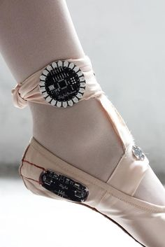 Designer: Leisa Trubat Name: E-Traces Made from regular pointe shoe and small electronics sewn in Tracks dancers movements and creates a video they can go back and look on an app.