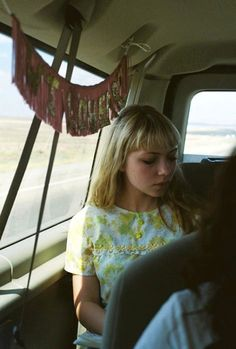 Me in the backseat with my Wild Heart banner. Vintage dress, banner from Nice on Etsy.