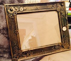 A personal favorite from my Etsy shop https://www.etsy.com/listing/260196130/steampunk-photo-frame-8x10-steampunk