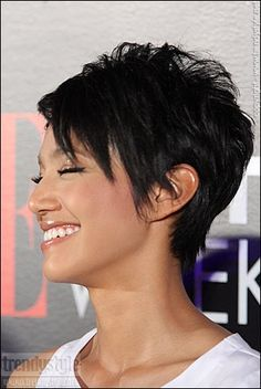 OR THIS?????   Cute pixie. I like how it is shorter in the back, medium and messy on top, and longer and sleepy in front.