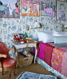 Pinks and blues from India, plus plenty of palm trees create this gorgeous happy bedroom by Lisa Fine.