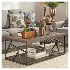 Add sleek, modern style to your space with this Logan Geometric Cutout Side Cocktail Table in Brown from Inspire Q. Boasting stylish practicality, this mixed-material coffee table will be the perfect complement to your living room. The metal geometric cutouts on the side along with the wooden tabletop and bottom shelf work together to create a look that'll fit right in with a variety of modernized decor styles. #livingroomcoffeetablesmodern