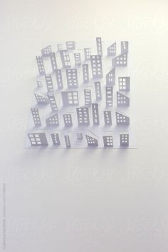 a city cut from a single piece of paper