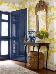 In Good Taste:  Sullen Gregory Design  Don't you love the glossy blue door with that yellow and white wallpaper?