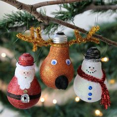 Santa, Rudolph, and a Snowman lightbulb ornaments