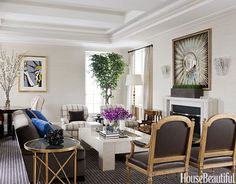 Gold is back in a big way. A few accents will warm up a room, like this classic living room.