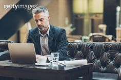 Middle age businessman working in comfortable environment - gettyimageskorea