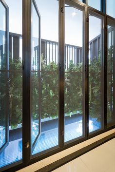 Image 32 of 50 from gallery of Tiwanon House / Archimontage Design Fields Sophisticated. Photograph by Beer Singnoi Facade Design, Wall Design, Cute Big Dogs, Design Fields, House Front Design, House 2, Luxury Villa, Home Projects, Luxury Cars
