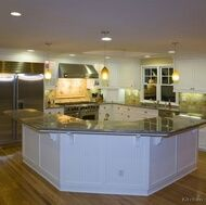 I could deal with this kitchen. But I would put the sink in the island, and some tall chairs around it.