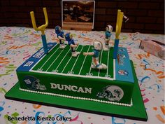 """Football field cake for a boy's 7th birthday party. Cake is 12"""" X 18"""" fondant covered vanilla cake filled with vanilla and chocolate swiss meringue buttercream. Cake design to include as per birthday boy football suspended through the goal posts."""