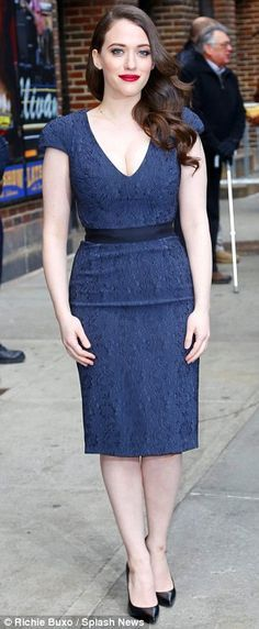 Kat Dennings. Classic beauty: The 27-year-old's red lipstick and brunette curls were reminiscent of Old Hollywood