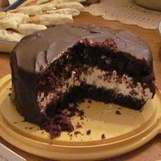 "Ho Ho Cake | ""Inspired by the Hostess®️️ favorite, the Ho Ho Cake features layers of cake and cream filling topped with chocolate."" #cakerecipes #bakingrecipes #dessertrecipes #cakes #cakemix #cheatcakerecipes #cheatsrecipes"