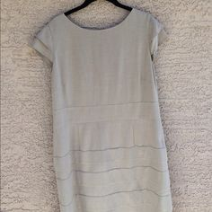 """Classic Tan Dress Beautifully made, tan dress with tiers on skirt. Exposed back zipper and fully lined. Seam on the lining at the waist band (inside) has a slight tear...just looks like the thread has come undone. Same thing on the right underarm. Can't be seen when wearing. Both could easily be fixed. 21"""" across chest, 19"""" waist, 36"""" length. Tahari Dresses"""