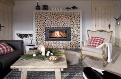 I'm not a big fan of cabiny style, but i love this fireplace!