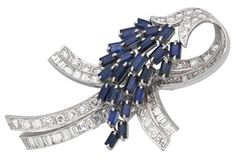 A SAPPHIRE AND DIAMOND BROOCH. Very cute. The blonde in the pic.