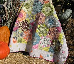 Kaleidoscope quilt. Hexagon block is made by sewing two strips of fabric together and cutting out triangles with a 60 degree equilateral triangle ruler. A gorgeous patchwork Quilt that is so easy to make.