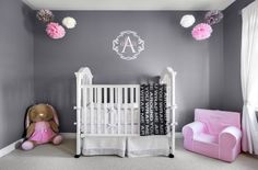Pink and Gray Nursery for a Baby Girl - love the bold gray walls and pink accents!