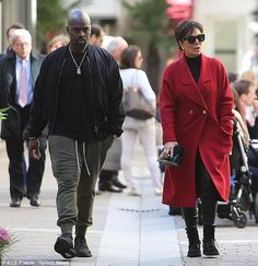 In the city of love: Kris hid her eyes behind a pair of shades as she wore a roll neck top with leather trousers