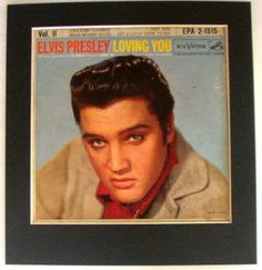 "Elvis - Loving You - 1957  From the 1957 movie ""Loving You"" - This is classic classic Elvis, authentic sleeves like these truly capture the very earliest stage of the King's era. This photo is the essence of Elvis, his shiny black hair slicked back, he almost snears directly at the viewer, assured we admire him.  This is a piece of Americana, a rarity of Rock & Roll history making for unique decor that will spur many a warm conversation, what other kind could we have when talking about…"
