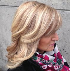 Medium Wavy Blonde Hairstyle For Women Over 50