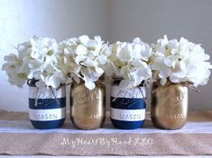 Nautical Baby Shower Centerpiece, Navy Blue and White Stripes Distressed Mason Jars, Painted Ball Jars, Rustic Home Decor, Gold Mason Jars by MyHeartByHand on Etsy decor blue gold This item is unavailable Gold Mason Jars, Distressed Mason Jars, Rustic Mason Jars, Gold Vases, Baby Shower Themes, Baby Boy Shower, Shower Ideas, Baby Shower Nautical, Nautical Baby Shower Decorations