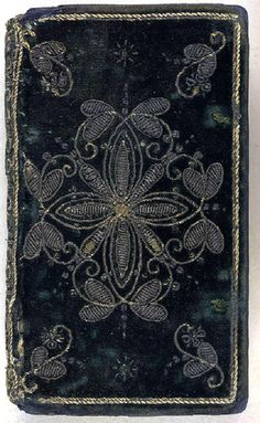 A 17th century embroidered velvet book cover. (London, 1620)