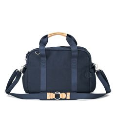 QWSTION - Overnighter - Organic Navy - If the Weekender is the cappuccino, the Overnighter is the espresso; it has the same base, but it's more compact and boiled down to the essence. The Overnighter offers a classic look in a compact format with highly contemporary style, while offering the same amount of versatility that you can find on it's big brother.