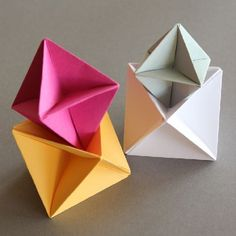 Diy Origami modular spinner, paper craft tutorial in German with explaining images.