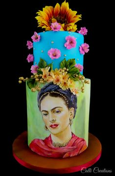 Frida Kahlo. Hand painted portrait using edible colours and cocoa butter. Sugar flowers blossoms and cold porcelain sunflower. Celebrating Day of the Dead. A Mexican tradition. A collaborative design submitted with many other cake artists around the globe. #sugarskulls #fridakahlo