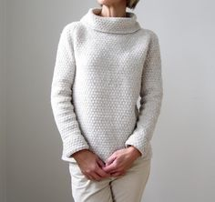 Cozy up for winter, or any time, in this textured pullover with a subtle 60's vibe. The texture is created through a simple combination of knit and purl stitches. The body can be made straight, as shown, or if you prefer a more traditional fit, waist shaping is provided as an option. Worked top-down and mostly in the round, it requires no seaming. Stitches for the collar are picked up and knit at the end. Intended to be worn with about 1 - 8 cm (½ - 3 inches) of positive ease. Length of body…