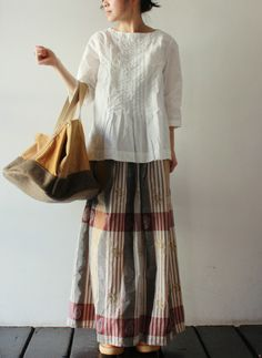 nice combo of shirt w/tucks and the plaid skirt.