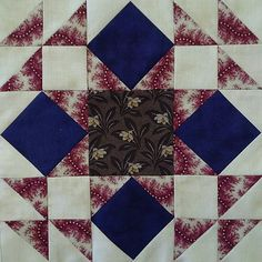 """Block #9 - Pattern is Unity star designed by Pam McMahon of Pam's Piece by Piece Quilt Designs. Unfinished block is 9 1/2""""."""