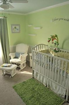 Gender Neutral Nursery Decor: We chose a very calming green paint for our baby boy's serene, green gender neutral nursery design. To complete the look we added antique white wainscotting