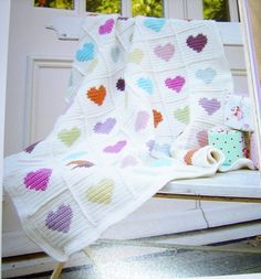 Granny Square Crochet Heart Blanket Free Pattern - Lap Blanket, Wood Chair, Crochet Blanket