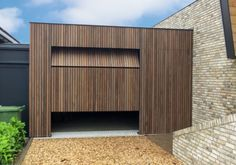 Vertical-plato, the garage door is right at the front doorclear Detail Architecture, Timber Garage, Aspen House, Garage Door Design, Front Windows, Wood Detail, House Front, Cladding, Planer