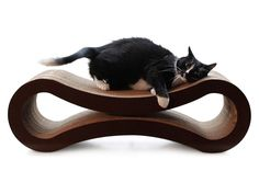 13 Cat-Approved Gifts for Fabulous Felines (And Their Humans) | Petfusion Deluxe Cat Scratcher Lounge This lounging spot is also an eco-friendly scratching pad, so I can scratch where I lay and lay where I scratch. The $50 price tag seems steep at first, but check it out: when the top gets worn, you can flip it upside down, and when that gets worn, you can saw it in half so I can scratch what used to be the inside of the lounger.  PetFusion  | WIRED.com