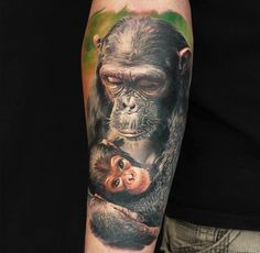 ... color-ink mother and baby chimpanzee tattoo on arm - Tattooimages.biz
